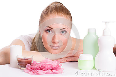 Beautiful woman face with skincare products