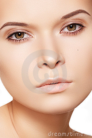 Beautiful woman face with soft clean healthy skin