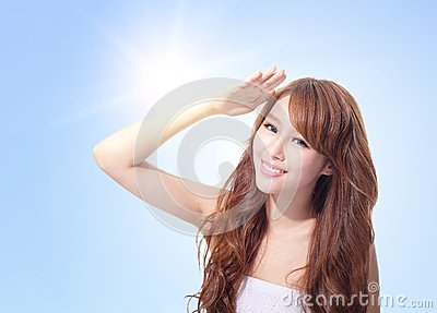 Beautiful woman face with sunshine and sky