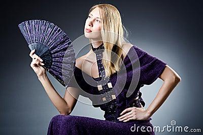 Beautiful woman with  fan