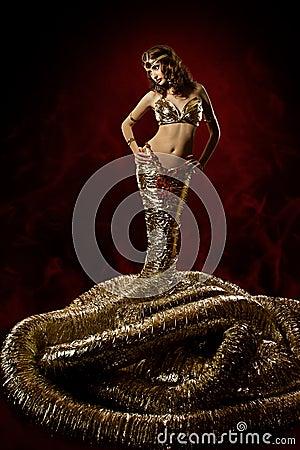 Beautiful woman in fantasy dress. Snake stylish
