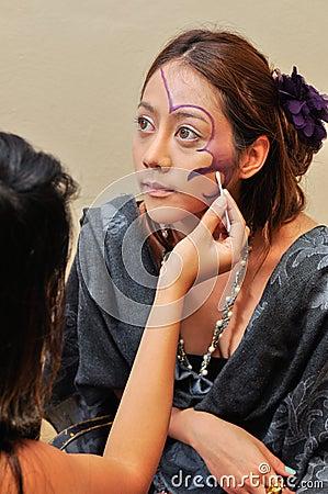 Beautiful woman with fashion make-up by beautician