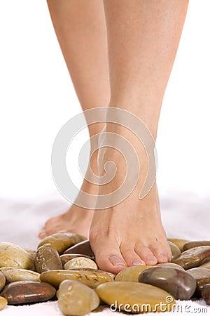 Free Beautiful Woman Feet On Stones. Stock Photos - 7935613