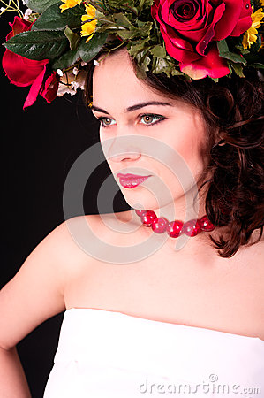 Beautiful woman in flower wreath portrait, white dress and red s