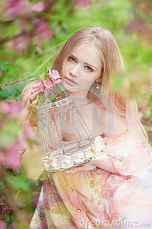 Beautiful woman and flowering tree