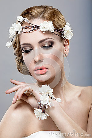 A beautiful woman with flowers on her head Stock Photo
