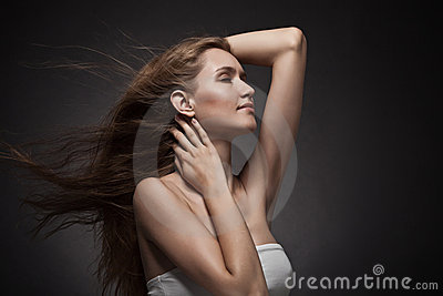 Beautiful woman with fluttering hair.