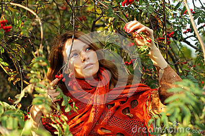 Beautiful woman in foliage