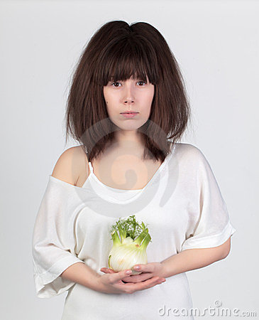 Beautiful woman with the fresh vegetables