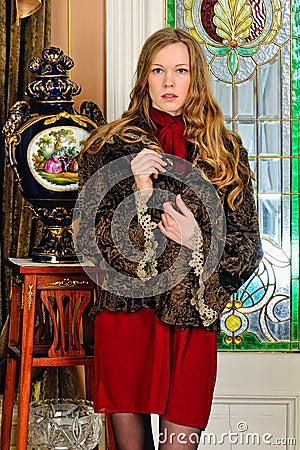 Beautiful woman in fur coat.