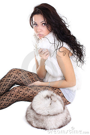Beautiful woman with fur hat  sitting