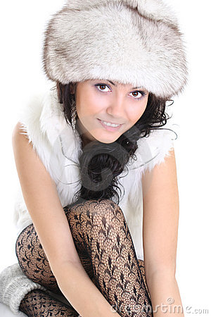 Beautiful woman in fur hat  sitting