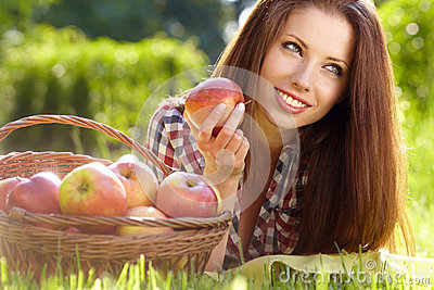 Beautiful woman  garden with apples