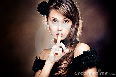 beautiful woman gesturing silence