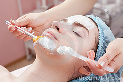Beautiful woman getting facial beauty treatment