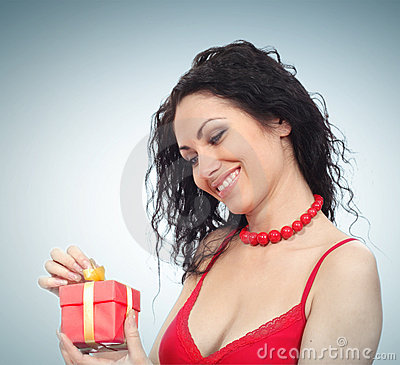 Beautiful woman with gift box