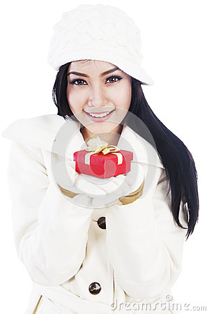 Beautiful woman giving a christmas gift 1