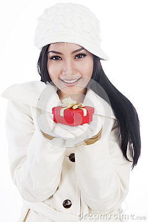 Beautiful woman giving a christmas gift