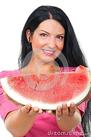 Beautiful woman giving watermelon