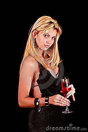 Beautiful woman with a glass of red wine on black