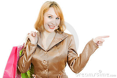 A beautiful woman in a gold suit with shopping