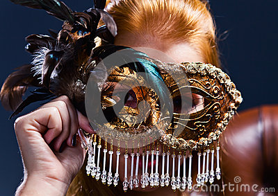 Beautiful woman with gold venetian mask
