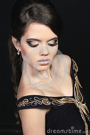 Beautiful woman with golden evening make-up