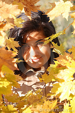 Beautiful woman with golden leafage