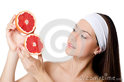 Beautiful woman with a grapefruit