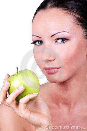 Beautiful woman with green apple in hand
