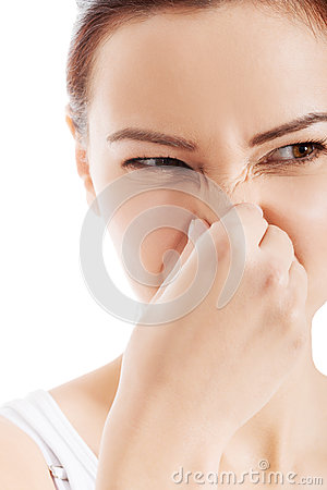 Beautiful woman with grimace beacuse of bad smell.
