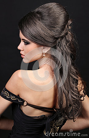 Beautiful woman with hairstyle luxuriant hair