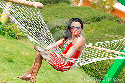 Beautiful woman on the hammock