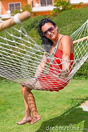 Beautiful woman on the hammock