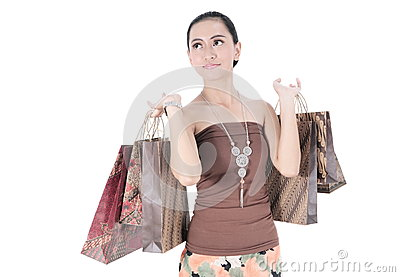 Beautiful woman happy holding shopping bags