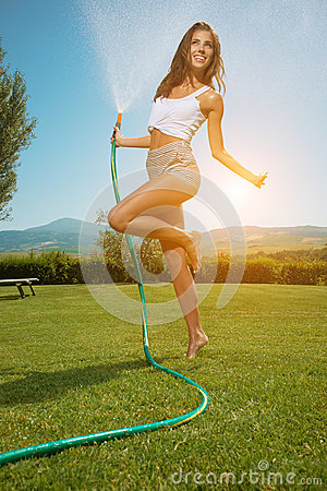 Free Beautiful Woman Having Fun In Summer Garden With Garden Ho Royalty Free Stock Photo - 52366445