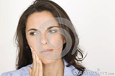 Beautiful woman having toothache