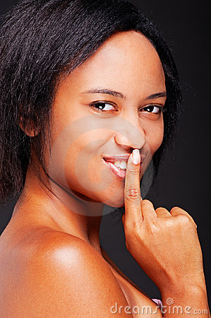 Beautiful woman with her finger over mouth