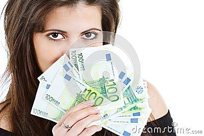 Beautiful woman hiding behind banknotes