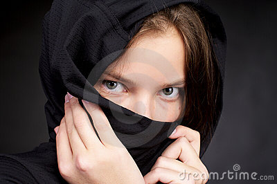 Beautiful woman hiding her face by