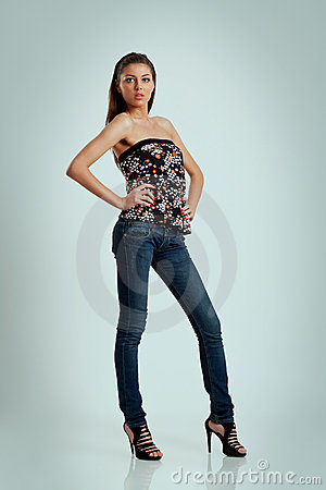 Beautiful woman in high heels and jeans