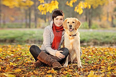 Beautiful woman and his dog (Labrador retriever)