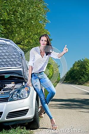 Beautiful woman hitchhiking