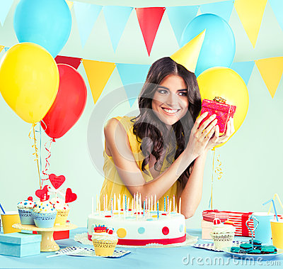 Free Beautiful Woman Holding A Present At Her Birthday Stock Photo - 41761730