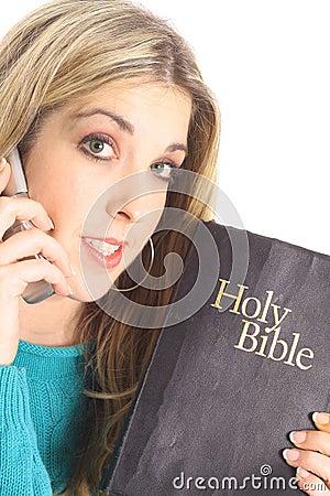 Beautiful woman holding a bible
