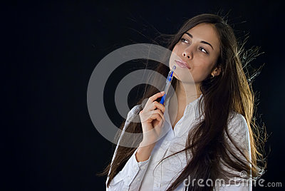 Beautiful woman holding blue pen