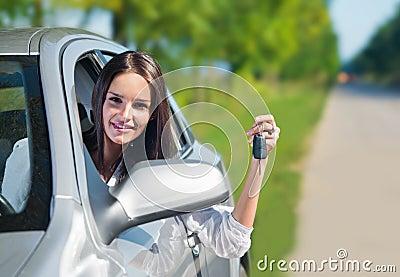 Beautiful woman holding car keys