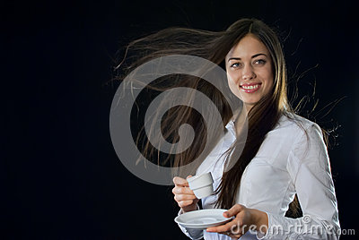 Beautiful woman holding cup of coffee