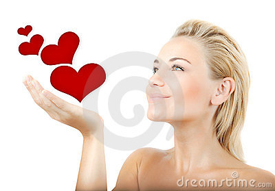 Beautiful woman holding hearts