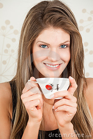 Beautiful woman holding a Japan cup of a tea
